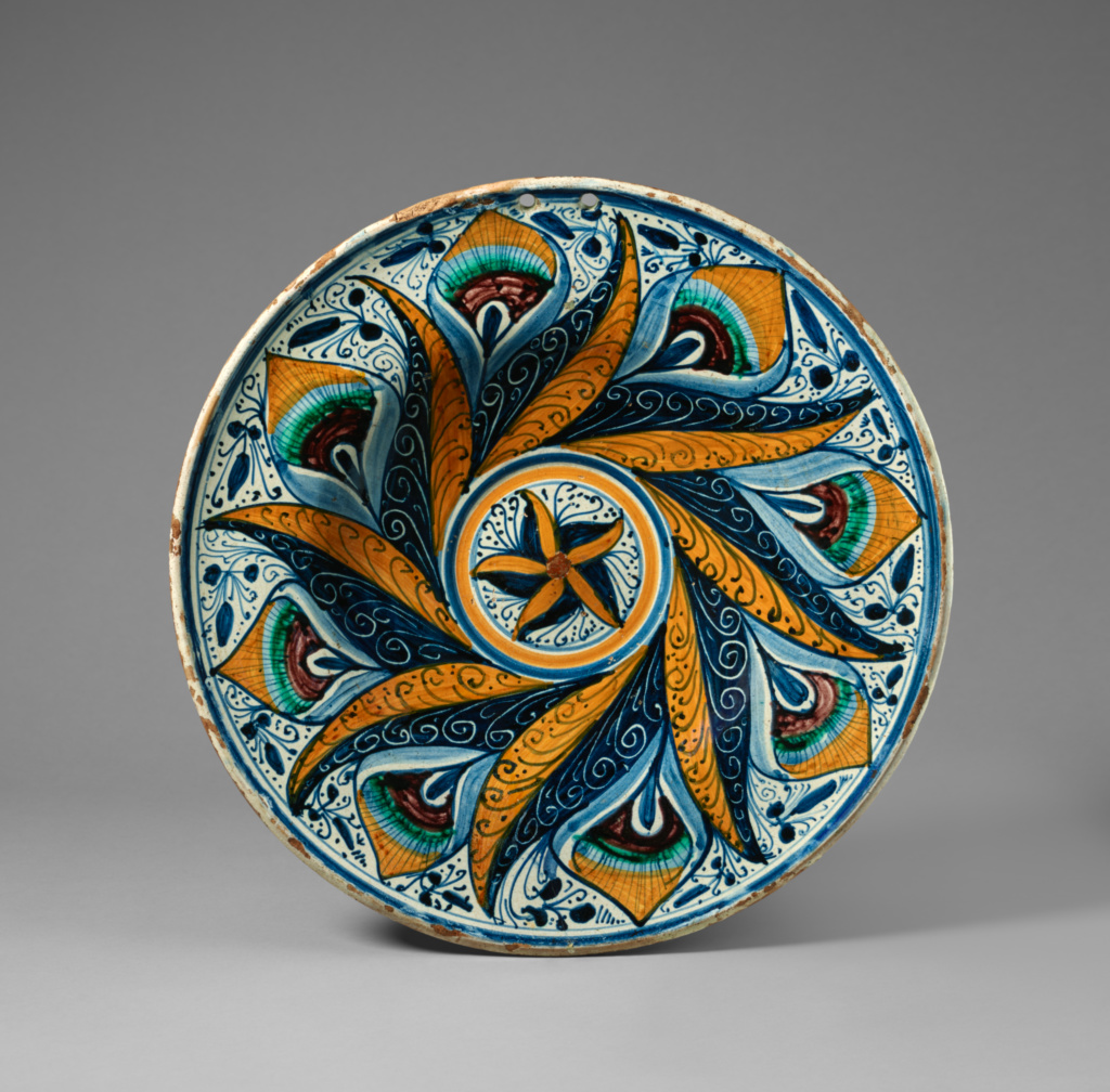 Dish with a Peacock Feather Pattern; Unknown; about 1470–1500; Tin-glazed earthenware; 6.4 × 39.1 cm (2 1/2 × 15 3/8 in.); 84.DE.103; Rights Statement: No Copyright - United States