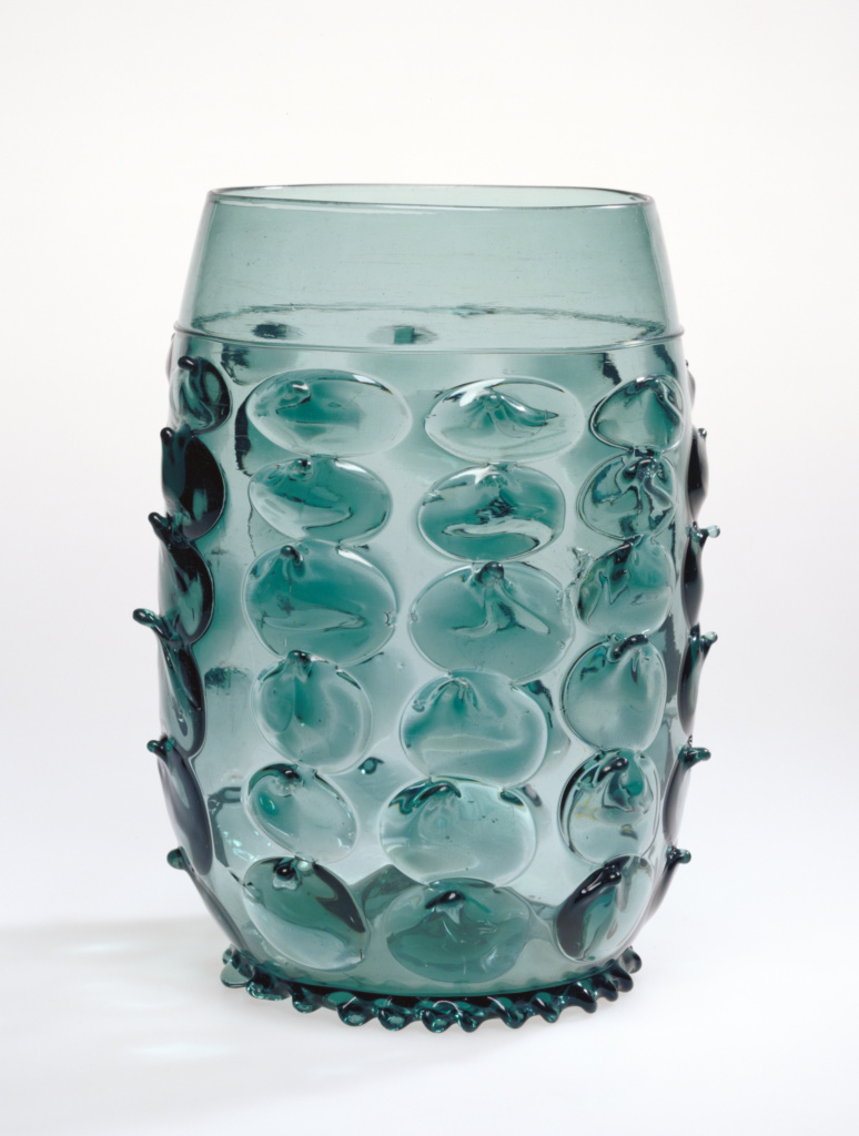 Prunted Beaker; Unknown; 16th century; Free-blown dark blue-green glass with applied decoration; 25.2 × 14.4 cm (9 15/16 × 5 11/16 in.); 84.DK.510; Rights Statement: No Copyright - United States