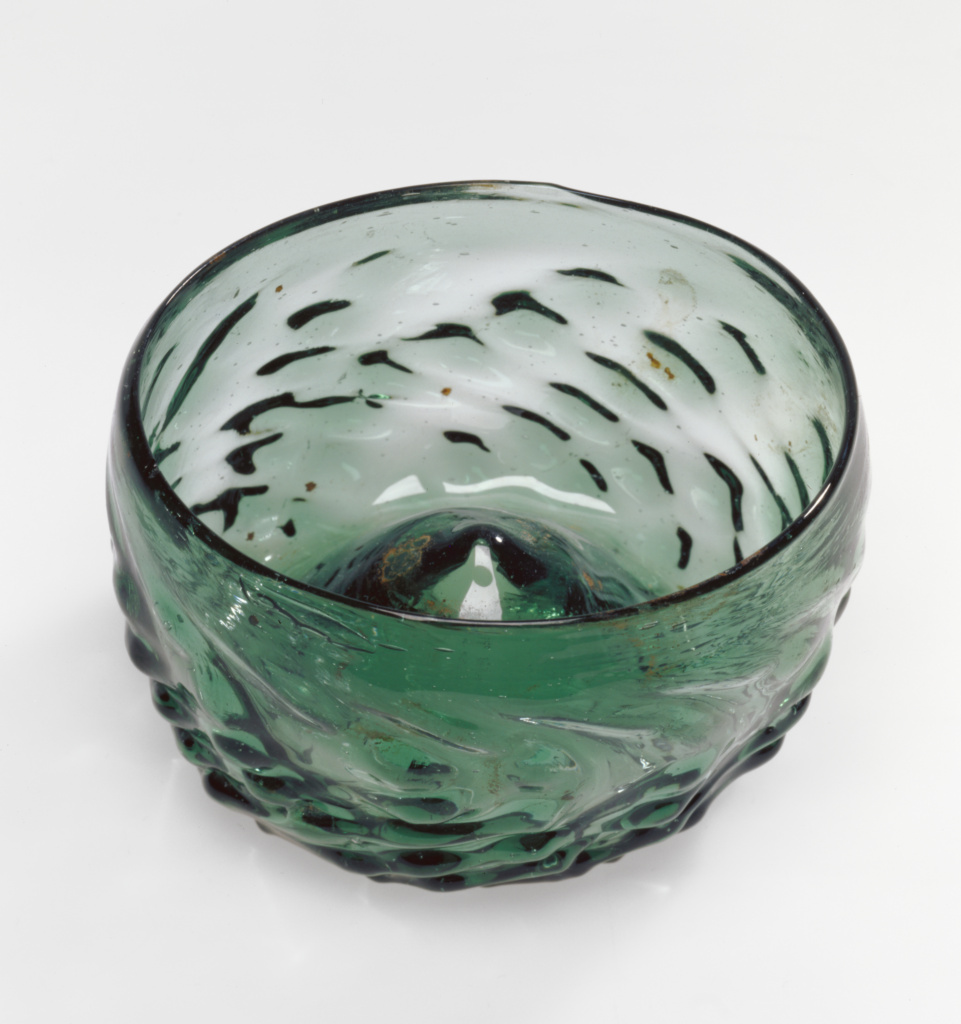 Drinking Bowl (Maigelein); Unknown; 15th century; Mold-blown dark green glass; 4.9 × 9 cm (1 15/16 × 3 9/16 in.); 84.DK.521; Rights Statement: No Copyright - United States