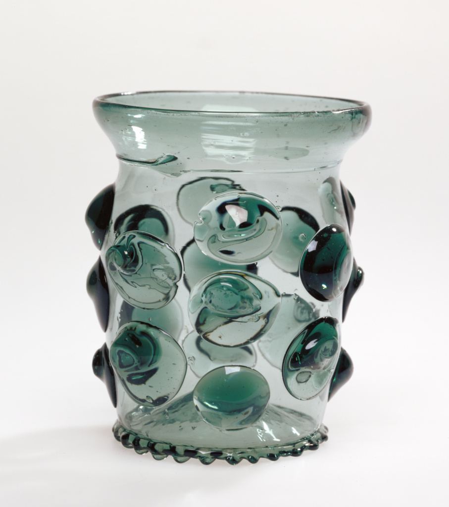 Prunted Beaker (Krautstrunk); Unknown; 1490 - 1530; Free-blown blue-green glass with applied decoration; 10.5 × 8.7 cm (4 1/8 × 3 7/16 in.); 84.DK.525; Rights Statement: No Copyright - United States