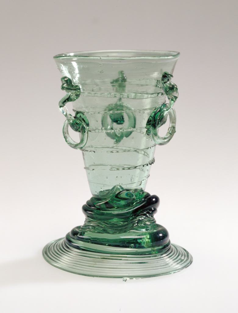 Ring Beaker (Ringbecher); Unknown; early 17th century; Free-blown blue-green glass with applied decoration; 12.1 × 7.8 × 8.7 cm (4 3/4 × 3 1/16 × 3 7/16 in.); 84.DK.531; Rights Statement: No Copyright - United States