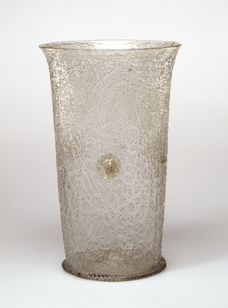 Ice-Glass Beaker; Unknown; late 16th or early 17th century; Free-blown colorless (slightly green) glass with gilding and applied decoration; 21.4 cm (8 7/16 in.); 84.DK.564; Rights Statement: No Copyright - United States