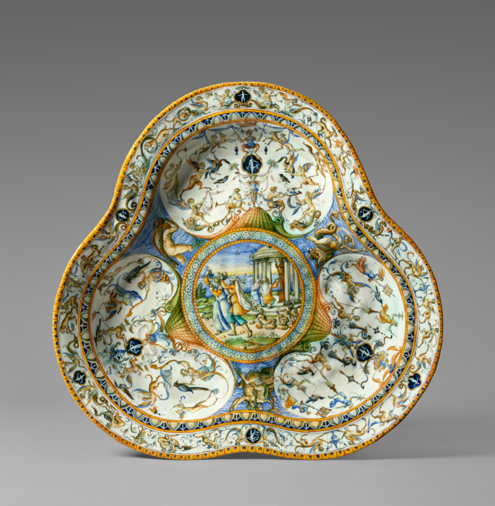 Basin with Deucalion and Pyrrha; Fontana Workshop, possibly Orazio Fontana (Italian, 1510 - 1571), or possibly Flaminio Fontana (Italian, active 1571 - 1591); about 1565–1575; Tin-glazed earthenware; 6.4 × 46.4 cm (2 1/2 × 18 1/4 in.); 86.DE.539; Rights Statement: No Copyright - United States