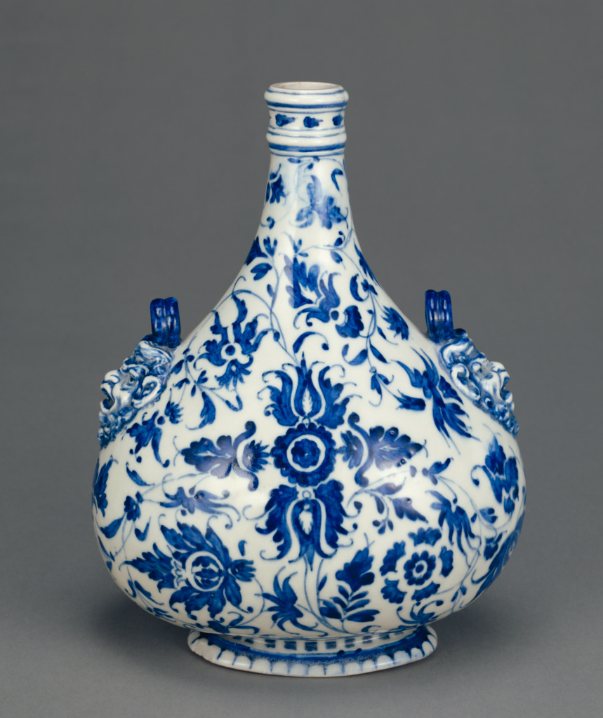 Pilgrim Flask; Medici Porcelain Factory (Italian, 1575 - early 17th century); Florence, Tuscany, Italy; 1580s; Soft-paste porcelain, underglaze blue decoration; 26.4 × 18.7 × 4.8 cm (10 3/8 × 7 3/8 × 1 7/8 in.); 86.DE.630; The J. Paul Getty Museum, Los Angeles; Rights Statement: No Copyright - United States