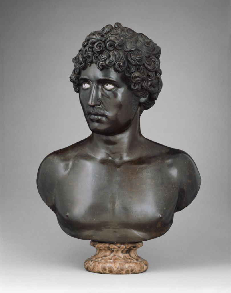 Bust of a Young Man; Antico (Pier Jacopo Alari-Bonacolsi) (Italian, about 1455 - 1528); about 1520; Bronze with silver; 54.6 × 45 × 22.3 cm (21 1/2 × 17 11/16 × 8 3/4 in.); 86.SB.688; Rights Statement: No Copyright - United States