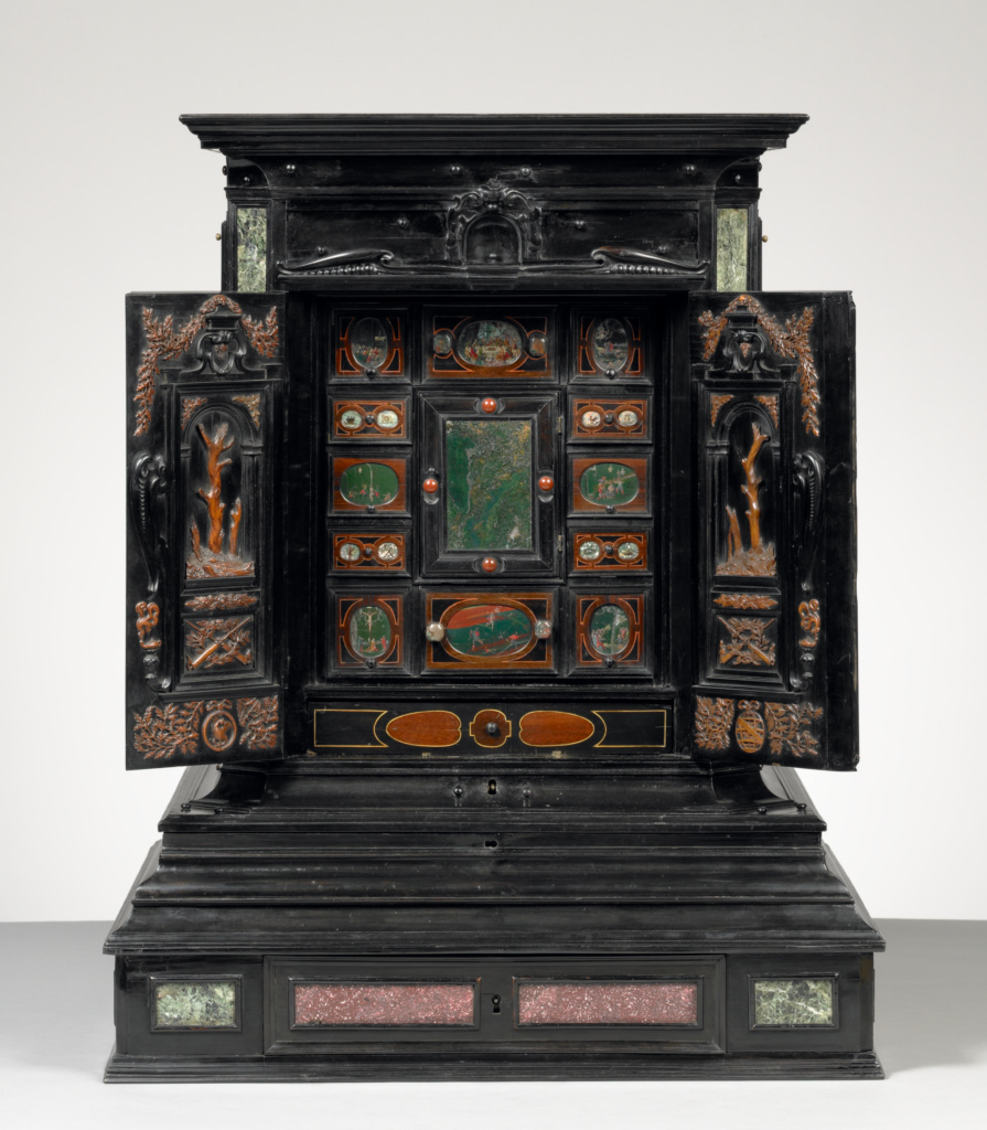 Display Cabinet (Kabinettschrank); Unknown, Three wood carvings by Albert Jansz. Vinckenbrinck (Dutch, about 1604 - 1664/1665); about 1630; Ebony and other tropical and European woods, porphyry, gemstones, marble, pewter, ivory, bone, tortoiseshell, enamel, mirror glass, brass, and painted stone; 73 × 57.9 × 59.1 cm, 53.0709 kg (28 3/4 × 22 13/16 × 23 1/4 in., 117 lb.); 89.DA.28; Rights Statement: No Copyright - United States