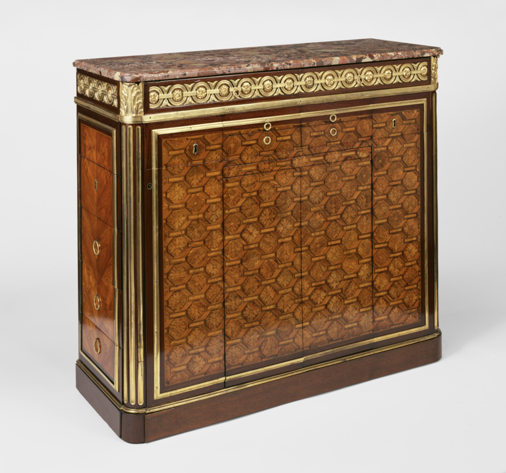 Secrétaire; Attributed to Jean-François Leleu (French, 1729 - 1807, master 1764); about 1770; Oak veneered with amaranth, bloodwood, tulipwood, and holly; gilt-bronze mounts; steel fittings, breche d'Alep top; 106.4 × 120 × 43.8 cm (41 7/8 × 47 1/4 × 17 1/4 in.); 82.DA.81; Rights Statement: No Copyright - United States