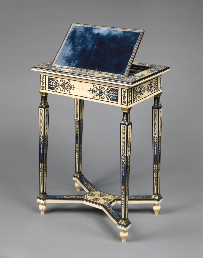 Writing Table; Unknown; Paris, France; about 1670–1675; Oak veneered with ivory, blue-painted horn, ebony, rosewood, and amaranth, with drawer of walnut; gilt-bronze moldings; brass; iron; modern velvet; 63.5 × 48.5 × 35.5 cm (25 × 19 1/8 × 14 in.); 83.DA.21; The J. Paul Getty Museum, Los Angeles; Rights Statement: No Copyright - United States