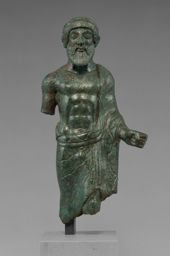 Statuette of a Bearded Man, Probably Tinia; Unknown; Etruria; about 480 B.C.; Bronze; 17.2 × 9 × 4 cm (6 3/4 × 3 9/16 × 1 9/16 in.); 55.AB.12; The J. Paul Getty Museum, Villa Collection, Malibu, California; Rights Statement: No Copyright - United States