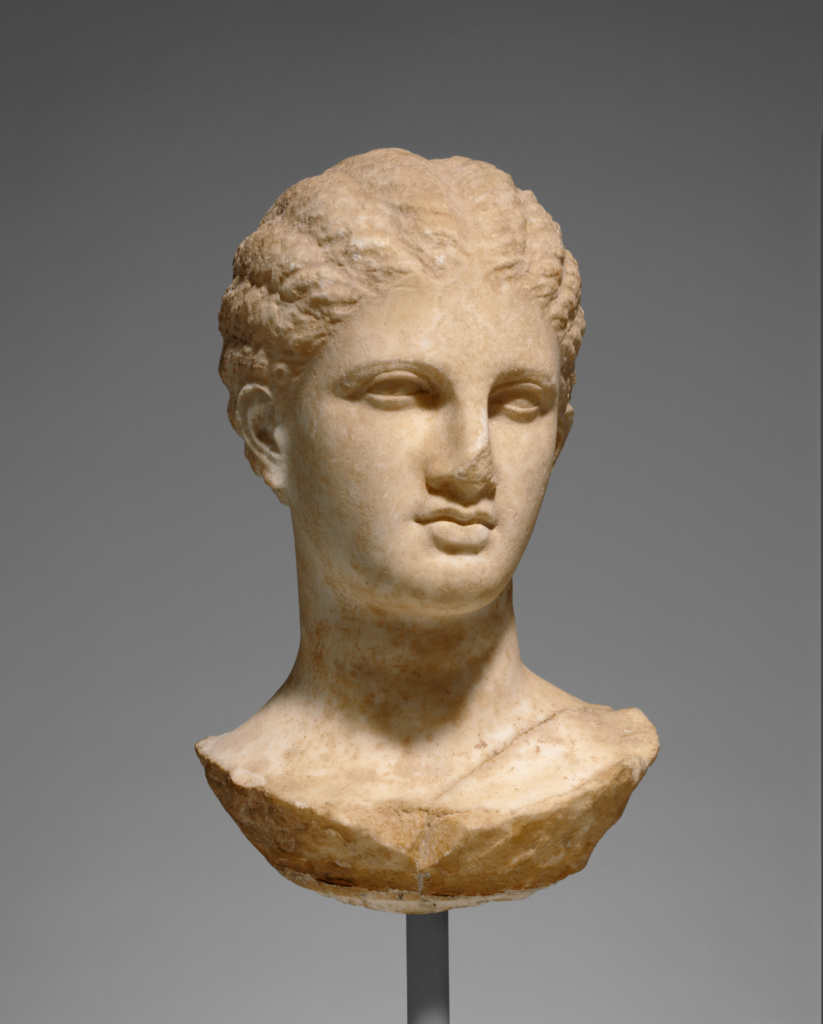 Head of a Young Woman from a Grave Naiskos; Unknown; Athens, Greece (Attica); about 320 B.C.; Marble; 34.3 × 15.6 × 22.2 cm (13 1/2 × 6 1/8 × 8 3/4 in.); 56.AA.19; The J. Paul Getty Museum, Villa Collection, Malibu, California; Rights Statement: No Copyright - United States