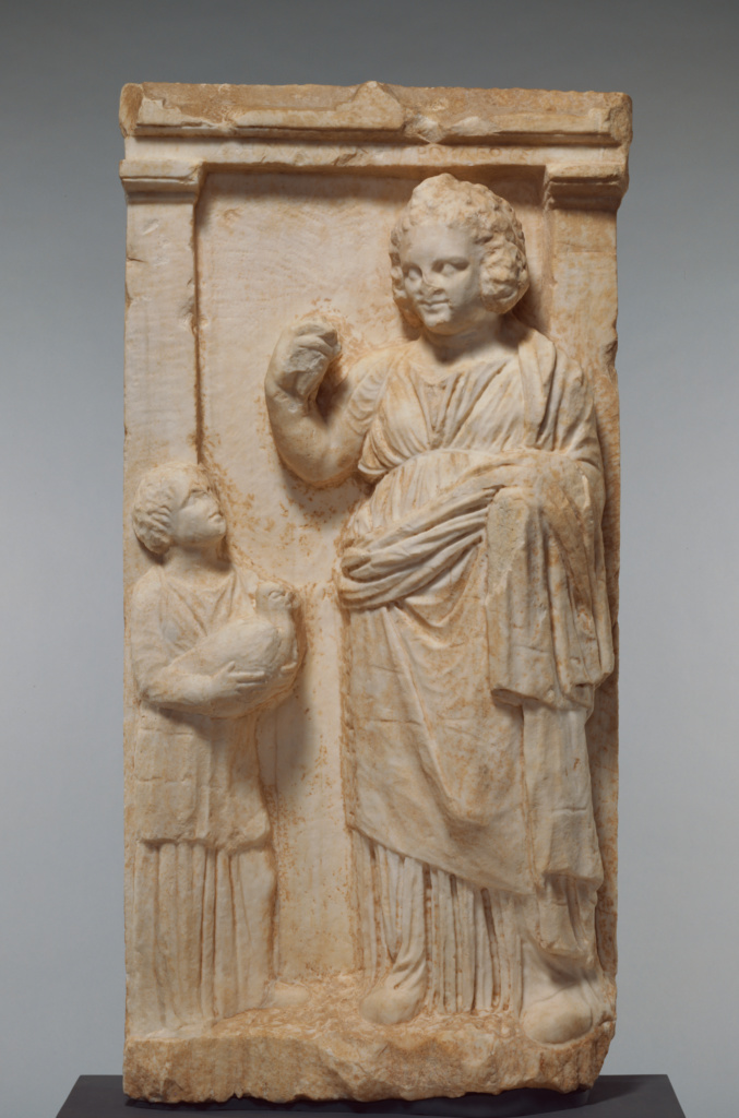 Grave Naiskos of Demainete with an Attendant Holding a Partridge; Unknown; Greece (Attica); about 310 B.C.; Marble; 96.5 × 47.5 × 15 cm, 80.3 kg (38 × 18 11/16 × 5 7/8 in., 177 lb.); 75.AA.63; The J. Paul Getty Museum, Villa Collection, Malibu, California; Rights Statement: No Copyright - United States