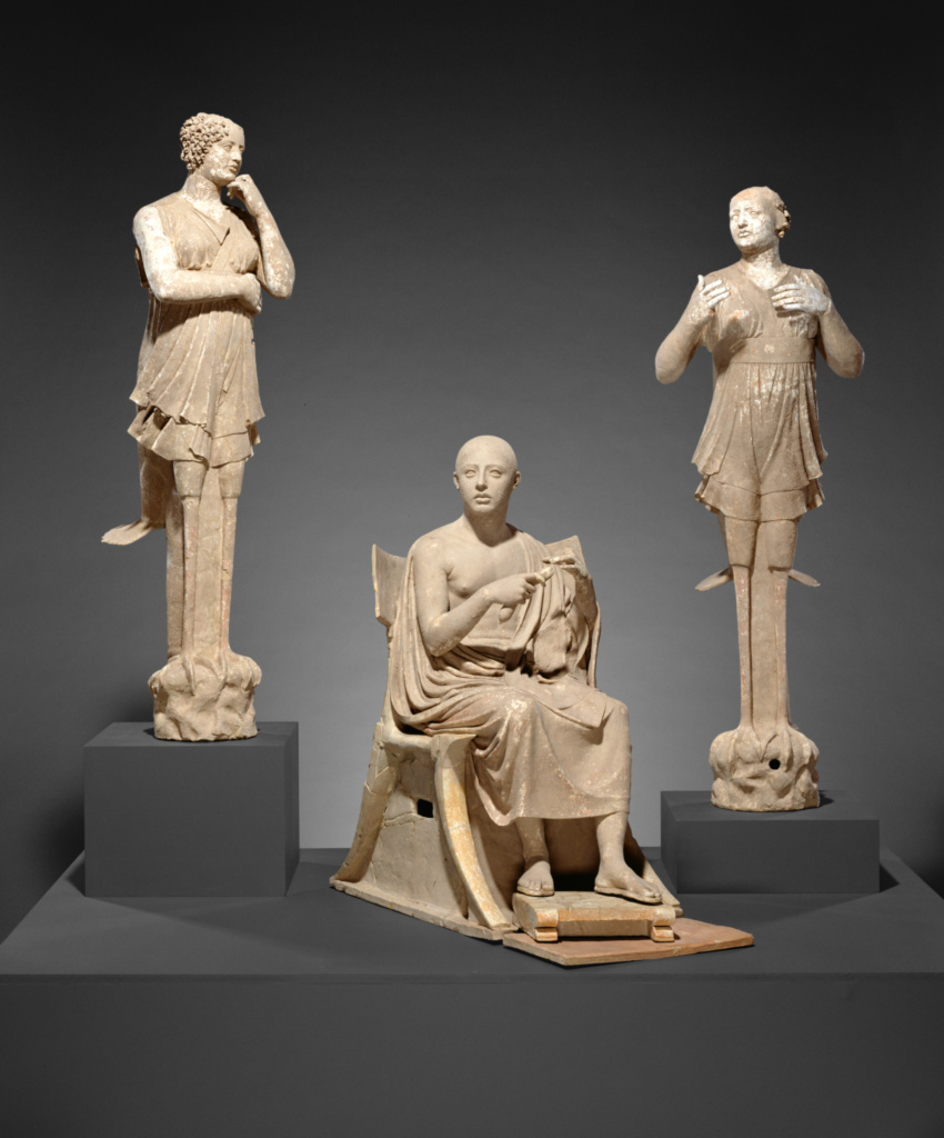 Sculptural Group of a Seated Poet and Sirens (2) with unjoined fragmentary curls (304); Unknown; Tarentum (Taras), South Italy; 350–300 B.C.; Terracotta with white slip of calcium carbonate and polychromy (orange-gold, black, red, gold-yellow, brown, pink); 76.AD.11; The J. Paul Getty Museum, Villa Collection, Malibu, California; Rights Statement: No Copyright - United States