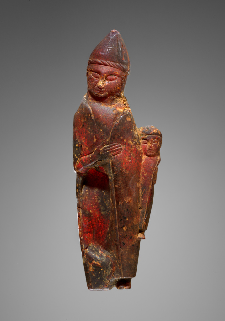 Pendant: Female Holding a Child (Kourotrophos); Unknown; Italy; 600–550 B.C.; Amber; 130 × 45 × 18 mm, 55.2 g (5 1/8 × 1 3/4 × 11/16 in., 0.1217 lb.); 77.AO.84; The J. Paul Getty Museum, Villa Collection, Malibu, California, Gift of Gordon McLendon; Rights Statement: No Copyright - United States