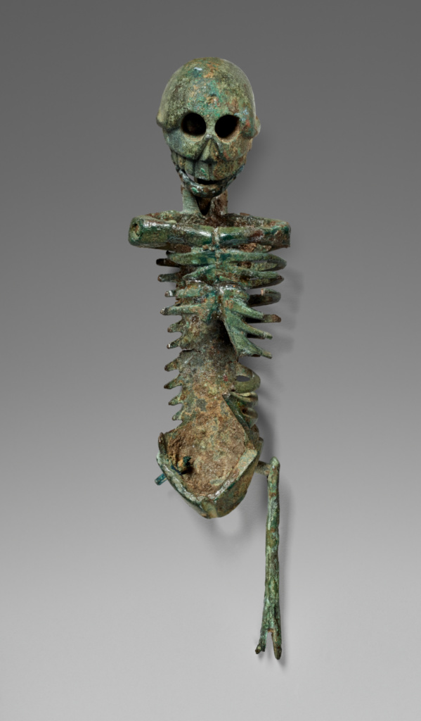 Miniature Skeleton; Unknown; 25 B.C.–A.D. 100; Bronze; 6.6 × 2 × 1 cm (2 5/8 × 13/16 × 3/8 in.); 78.AB.307; Rights Statement: No Copyright - United States