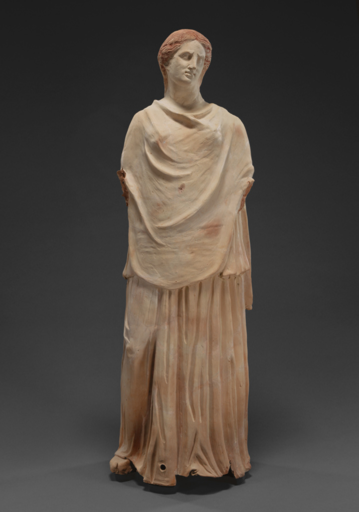 Statue of a Mourning Woman; Unknown; 300–250 B.C.; Terracotta with polychromy (red pigment); 96.5 × 31 cm (38 × 12 3/16 in.); 79.AD.194; Gift of Dr. Paul Flanagan; Rights Statement: No Copyright - United States