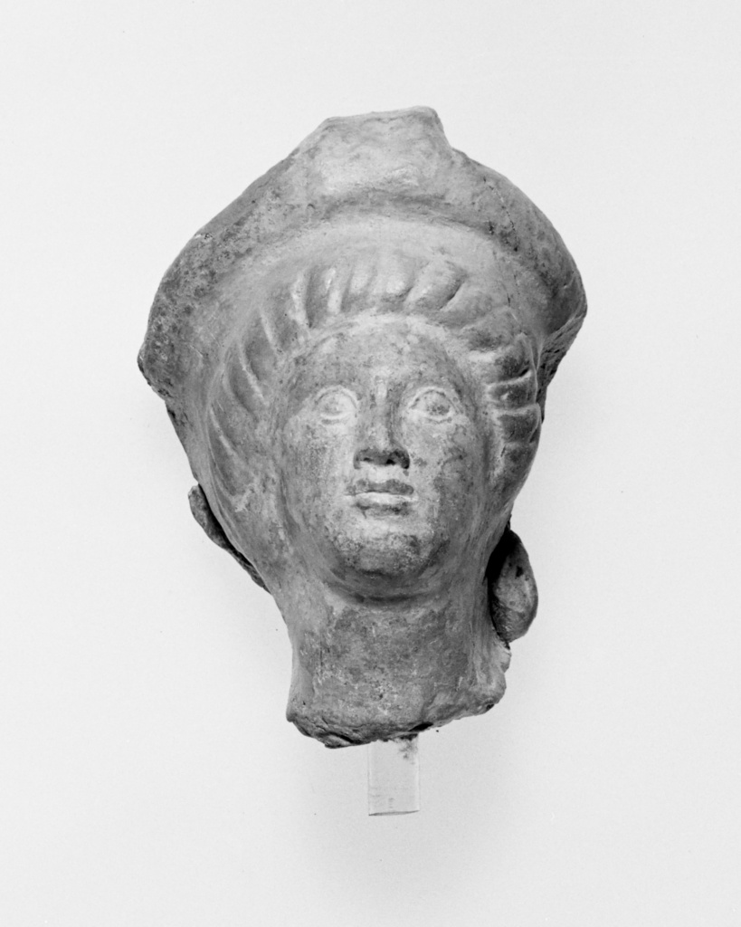 Votive Head; Unknown; Taranto, South Italy; late 5th century B.C.; Terracotta; 9 cm (3 9/16 in.); 80.AD.74; The J. Paul Getty Museum, Villa Collection, Malibu, California, Gift of J. P. Grosz; Rights Statement: No Copyright - United States