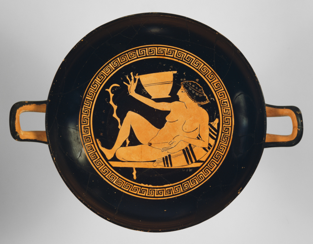 Attic Red-Figure Kylix; Attributed to Onesimos (Greek (Attic), active 500 - 480 B.C.); about 490 B.C.; Terracotta; 8.5 × 36.9 cm (3 3/8 × 14 1/2 in.); 82.AE.14; Rights Statement: No Copyright - United States