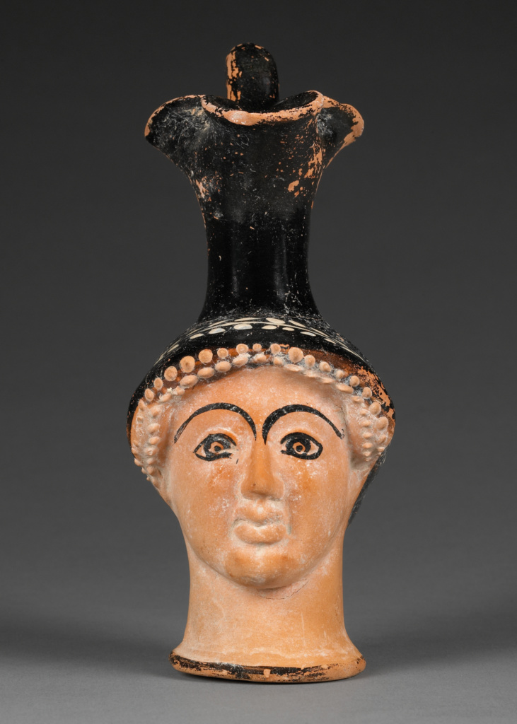 Attic Head Vase; Sabouroff Class (Greek (Attic)); Athens, Greece; about 470 B.C.; Terracotta; 18.8 cm (7 3/8 in.); 83.AE.242; The J. Paul Getty Museum, Villa Collection, Malibu, California, Gift of Herbert L. Lucas; Rights Statement: No Copyright - United States