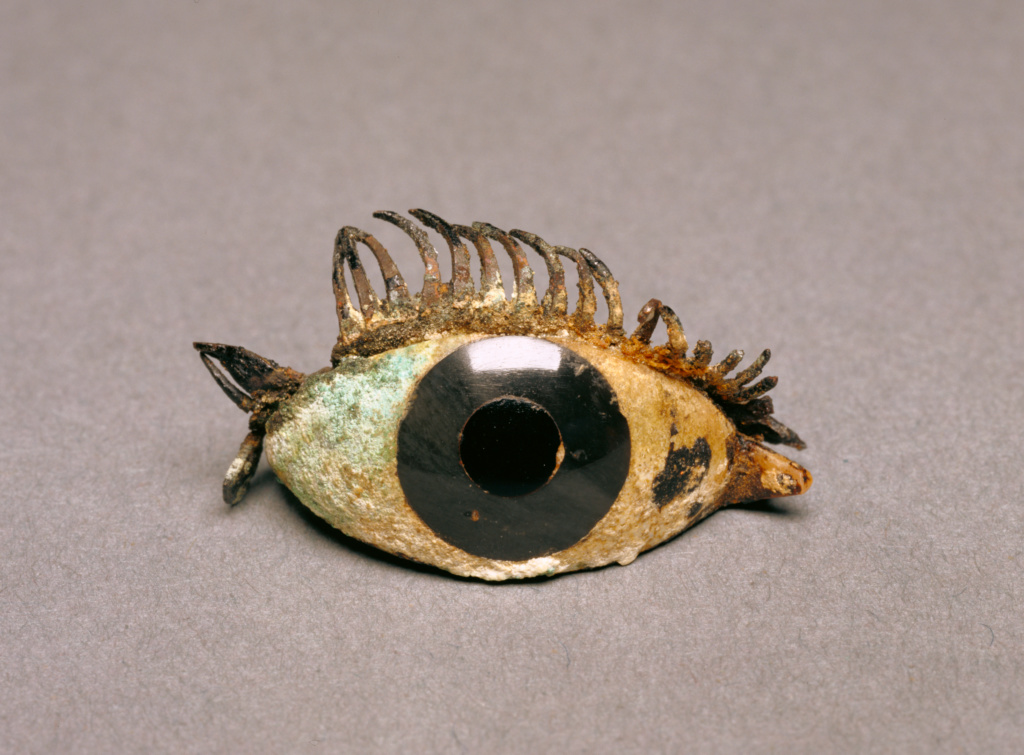 Eye from a Bronze Statue; Unknown; 5th - 2nd century B.C.; Marble, obsidian, glass, and copper; 2.1 × 4.9 cm (13/16 × 1 15/16 in.); 84.AI.625; The J. Paul Getty Museum, Villa Collection, Malibu, California; Rights Statement: No Copyright - United States