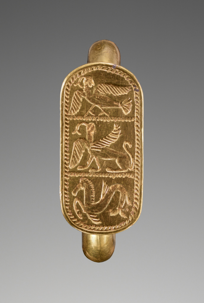 Ring with a Siren, a Sphinx, and a Hippocamp; Unknown; 550–500 B.C.; Gold; 1.9 × 0.9 cm (3/4 × 3/8 in.); 85.AM.268; Rights Statement: No Copyright - United States
