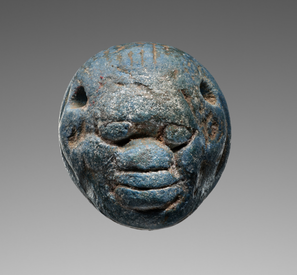 """Seal in the form of a Black African head, engraved with an animal combat; Unknown; Naucratis, Egypt; early 6th century B.C.; Frit (""""Egyptian Blue""""); 1.5 × 1.4 × 0.9 cm (5/8 × 9/16 × 3/8 in.); 85.AN.370.5; The J. Paul Getty Museum, Villa Collection, Malibu, California; Rights Statement: No Copyright - United States"""