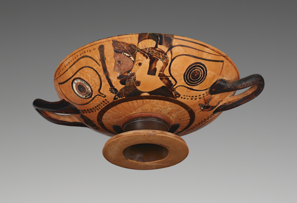 Attic Black-Figure Eye Cup; Attributed to the Painter of the Villa Giulia 63613 (Greek, active about 530 - 510 B.C.), Signed by Nikosthenes (Greek (Attic), active Athens, Greece 540 - 510 B.C.); about 530 B.C.; Terracotta; 11.4 × 34.4 cm (4 1/2 × 13 1/2 in.); 86.AE.170; Rights Statement: No Copyright - United States