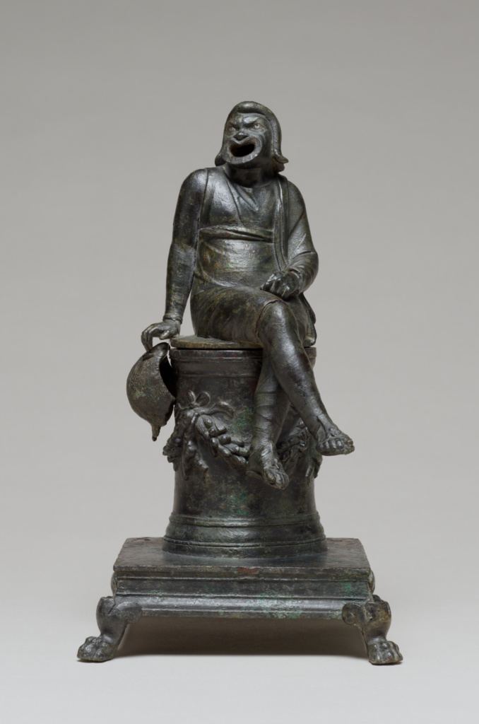 Thymiaterion in the Form of a Comic Actor Seated on an Altar and a Separate Theatrical Wig; Unknown; first half of 1st century A.D.; Bronze with silver inlay; 87.AC.143; The J. Paul Getty Museum, Villa Collection, Malibu, California; Rights Statement: No Copyright - United States