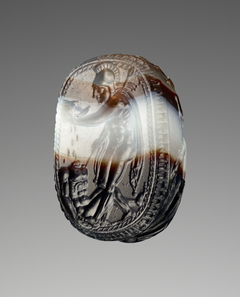 Engraved Scarab with a Warrior Holding a Head; Unknown; Etruria; 400–375 B.C.; Banded brown and white agate; 1.1 × 0.9 × 1.7 cm (7/16 × 5/16 × 5/8 in.); 92.AN.85; The J. Paul Getty Museum, Villa Collection, Malibu, California; Rights Statement: No Copyright - United States