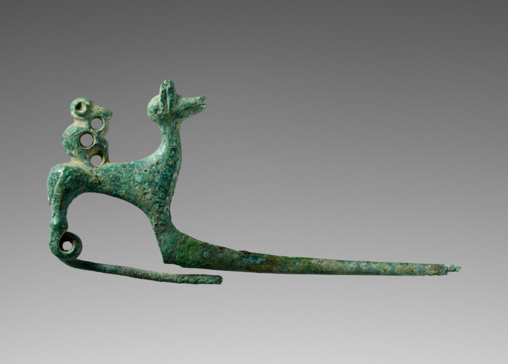 Fibula with a Deer and a Monkey; Unknown; Etruria; 700–650 B.C.; Bronze; 3.8 × 7.6 × 2 cm (1 1/2 × 3 × 13/16 in.); 91.AC.20; The J. Paul Getty Museum, Villa Collection, Malibu, California; Rights Statement: No Copyright - United States