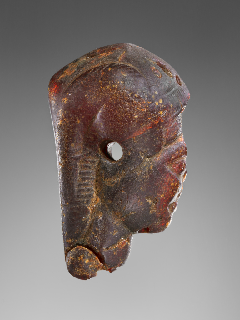 Pendant: Winged Female Head in Profile; Unknown; 525–480 B.C.; Amber; 79 × 49 × 25 mm (3 1/8 × 1 15/16 × 1 in.); 76.AO.85.2; Gift of Gordon McLendon; Rights Statement: No Copyright - United States