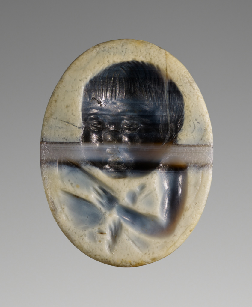 Engraved Gem with Cupid holding a Butterfly; Unknown; first half of 1st century A.D.; Banded agate; 1.5 × 1.2 × 0.4 cm (5/8 × 7/16 × 3/16 in.); 84.AN.1.36; The J. Paul Getty Museum, Villa Collection, Malibu, California; Rights Statement: No Copyright - United States