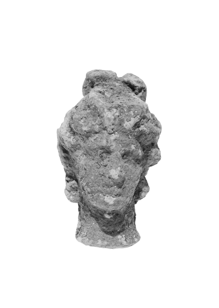 Head with Melon Coiffure and Bow Knot; Unknown; mid-3rd century B.C.; Terracotta (pale brown clay); 4.2 cm (1 5/8 in.); 83.AD.354.101; Gift of Stefan Hornak; Rights Statement: No Copyright - United States