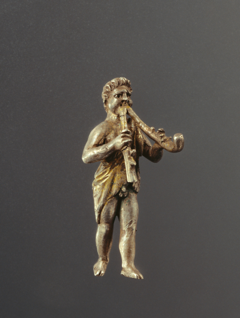 Statuette of a Young Satyr Playing the Double Aulos; Unknown; Roman Empire; A.D. 150–200; Silver with gilding; 4.2 cm (1 5/8 in.); 96.AM.206; The J. Paul Getty Museum, Villa Collection, Malibu, California, Gift of Barbara and Lawrence Fleischman; Rights Statement: In Copyright; Image: Bruce White Photography