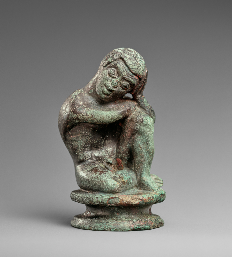 Statuette of a Seated Black African Boy; Unknown; Populonia, Etruria; 450–425 B.C.; Bronze; 5.7 × 3.3 × 3.1 cm (2 1/4 × 1 5/16 × 1 1/4 in.); 96.AC.128; The J. Paul Getty Museum, Villa Collection, Malibu, California, Gift of Barbara and Lawrence Fleischman; Rights Statement: In Copyright; Image: Bruce White Photography