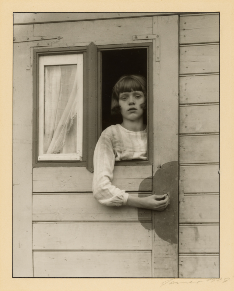 Young Girl in a Circus Wagon, Düren; August Sander (German, 1876 - 1964); Düren, Germany; 1929; Gelatin silver print; 29.4 × 22.9 cm (11 9/16 × 9 in.); 84.XM.126.223; The J. Paul Getty Museum, Los Angeles; Rights Statement: In Copyright; Copyright: © J. Paul Getty Trust