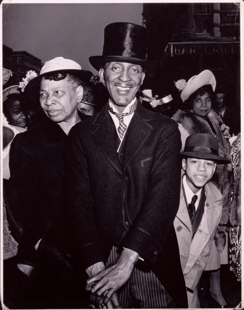 Easter Sunday in Harlem; Weegee (Arthur Fellig) (American, born Austria, 1899 - 1968); New York, New York, United States; negative 1940; print about 1950; Ferrotyped gelatin silver print; 34.7 × 27 cm (13 11/16 × 10 5/8 in.); 84.XM.190.8; The J. Paul Getty Museum, Los Angeles; Rights Statement: In Copyright; Copyright: © International Center of Photography