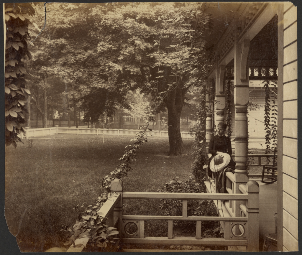 [Young woman on porch railing, Maple City]; Edward H. Hart (American, active about 1890); Maple City, Michigan, United States; late 19th century; Albumen silver print; 15.5 × 18.2 cm (6 1/8 × 7 3/16 in.); 84.XP.715.4; The J. Paul Getty Museum, Los Angeles; Rights Statement: No Copyright - United States