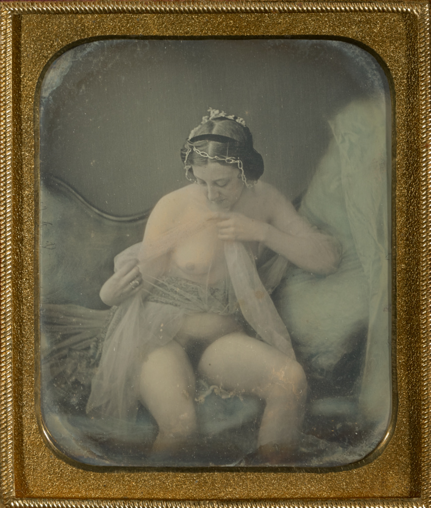 [Female Nude in Diaphanous Gown Admiring One of Her Breast]; Unknown maker, French; about 1855; Daguerreotype, hand-colored; 6.8 × 5.7 cm (2 11/16 × 2 1/4 in.); 84.XT.1582.17; The J. Paul Getty Museum, Los Angeles; Rights Statement: No Copyright - United States