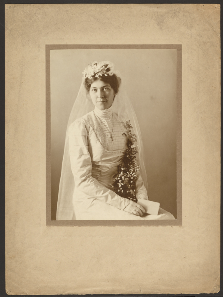 [Portrait of a Bride with Orange Blossoms]; Louis Fleckenstein (American, 1866 - 1943); 1907–1943; Gelatin silver print; 24 × 17.8 cm (9 7/16 × 7 in.); 85.XM.28.275; The J. Paul Getty Museum, Los Angeles; Rights Statement: No Copyright - United States