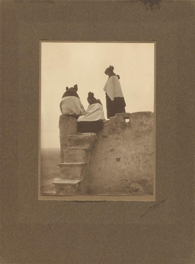 [Hopi, Watching the Dancers]; Edward S. Curtis (American, 1868 - 1952); 1906; Gelatin silver print or platinum print; 19.7 × 14.7 cm (7 3/4 × 5 13/16 in.); 85.XM.241.2; Rights Statement: No Copyright - United States