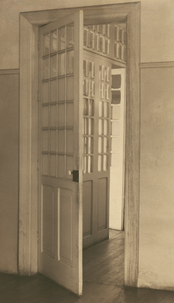 Open Doors, Mexico City; Tina Modotti (American, born Italy, 1896 - 1942); 1925; Palladium print; 24.1 × 13.7 cm (9 1/2 × 5 3/8 in.); 86.XM.722.5; The J. Paul Getty Museum, Los Angeles; Rights Statement: No Copyright - United States