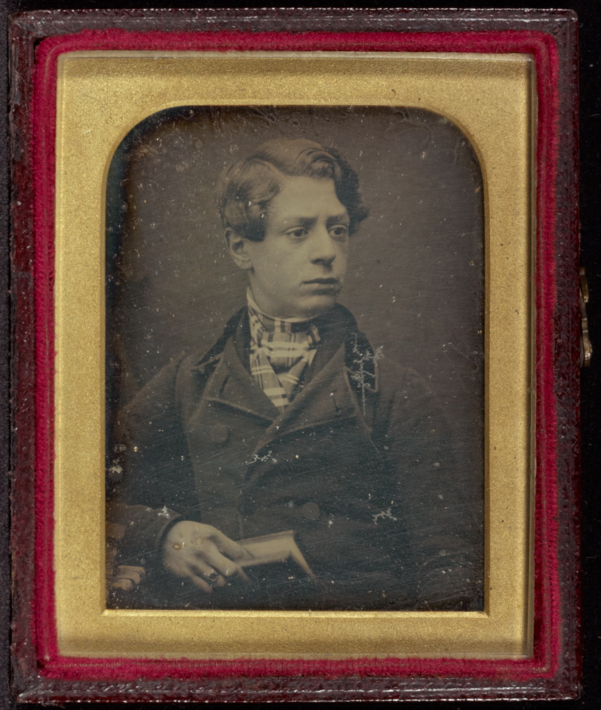 [Portrait of a Young Man Holding a Book]; Antoine Claudet (French, 1797 - 1867); France; about 1847; Daguerreotype; 5.2 × 3.8 cm (2 1/16 × 1 1/2 in.); 84.XT.266.4; The J. Paul Getty Museum, Los Angeles; Rights Statement: No Copyright - United States