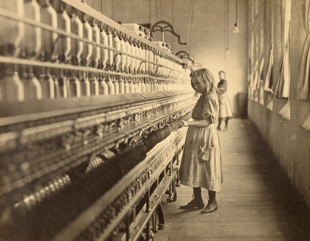 Sadie Pfeiffer, Spinner in Cotton Mill, North Carolina; Lewis W. Hine (American, 1874 - 1940); North Carolina, United States; negative 1910; print about 1920s - 1930s; Gelatin silver print; Sheet: 28 × 35.7 cm (11 × 14 1/16 in.); 84.XM.967.15; The J. Paul Getty Museum, Los Angeles; Rights Statement: No Copyright - United States
