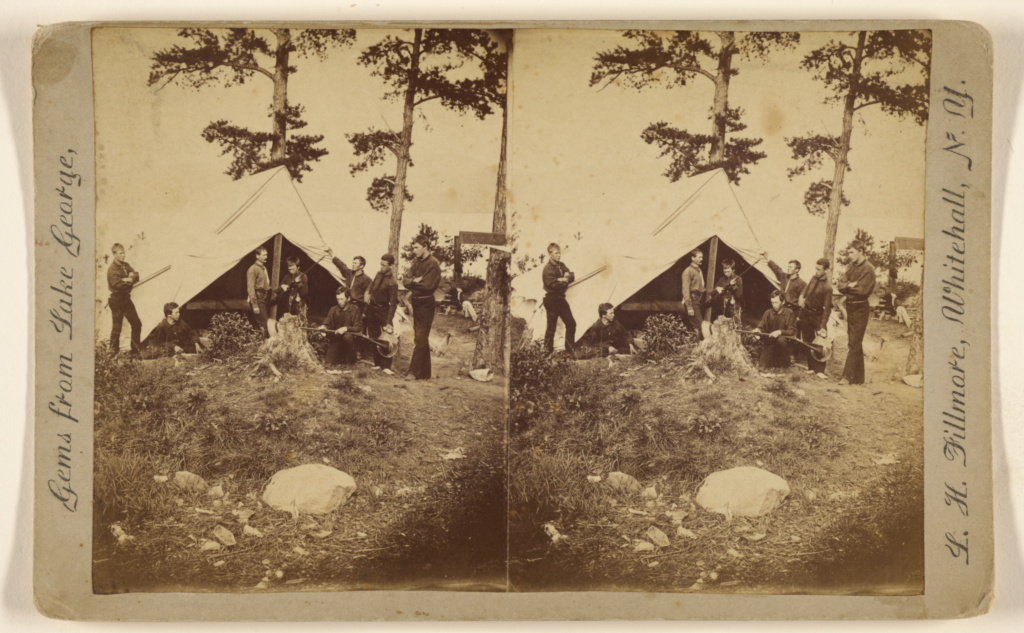 7515b70f93e Camp scene  men with guns in front of tent