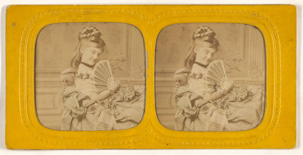 [Woman seated on a divan holding a hand fan]; E. Lamy (French, active 1860s - 1870s); 1860s; Hand-colored albumen silver print; 84.XC.979.9658; The J. Paul Getty Museum, Los Angeles, Gift of Weston J. and Mary M. Naef; Rights Statement: No Copyright - United States