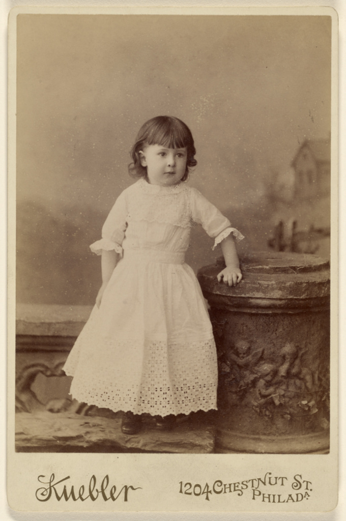 [Unidentified little girl, standing]; Kuebler (American, active Baltimore, Maryland 1880s - 1890s); about 1880; Albumen silver print; 84.XD.879.185; The J. Paul Getty Museum, Los Angeles; Rights Statement: No Copyright - United States