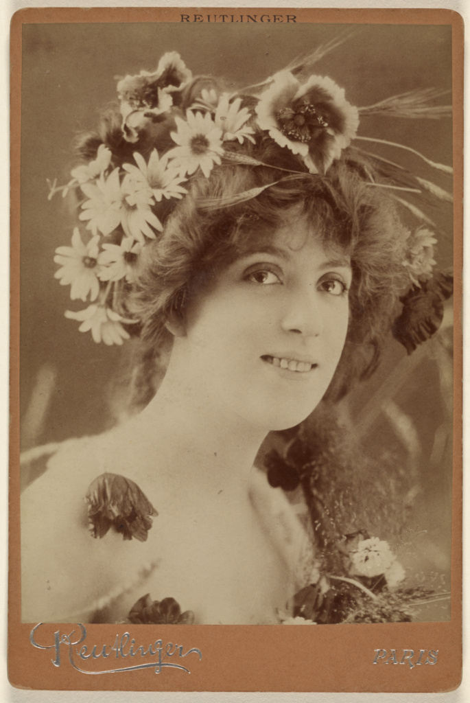 Faber l'Ete [Woman with flowers in her hair]; Emile Auguste Reutlinger (French, 1825 - 1907); 1890s; Albumen silver print; 84.XD.879.304; The J. Paul Getty Museum, Los Angeles; Rights Statement: No Copyright - United States