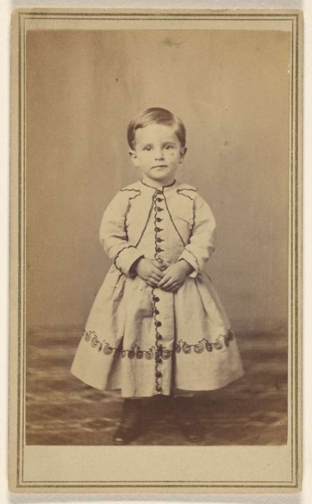 Dinkenspiel Boy [boy with short hair, wearing a dress-like garment, standing]; William J. Shew (American, 1820 - 1903); 1870–1875; Albumen silver print; 84.XD.1157.733; The J. Paul Getty Museum, Los Angeles; Rights Statement: No Copyright - United States