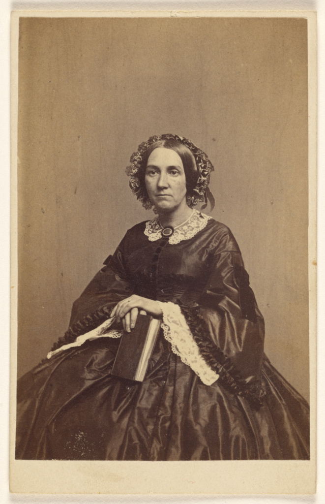 [Unidentified woman holding a book, seated]; K.W. Beniczky (American, active New York, New York 1850s - 1860s); 1865–1870; Albumen silver print; 84.XD.1157.828; Rights Statement: No Copyright - United States