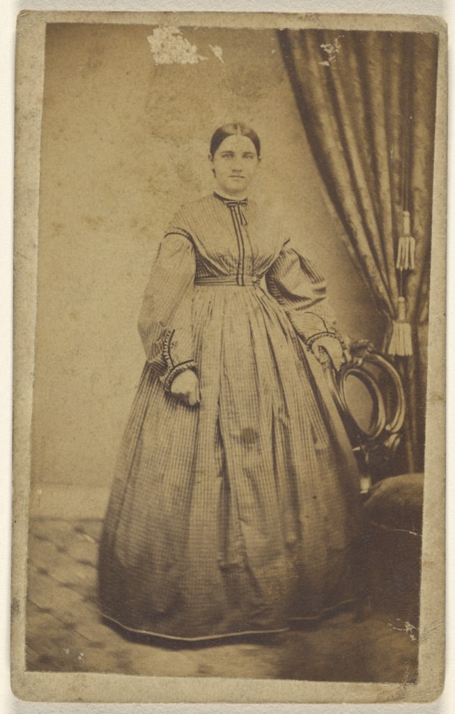[Unidentified woman, standing]; Benjamin Lochman (American, active 1850s - 1910s); 1870–1875; Albumen silver print; 84.XD.1157.1050; The J. Paul Getty Museum, Los Angeles; Rights Statement: No Copyright - United States
